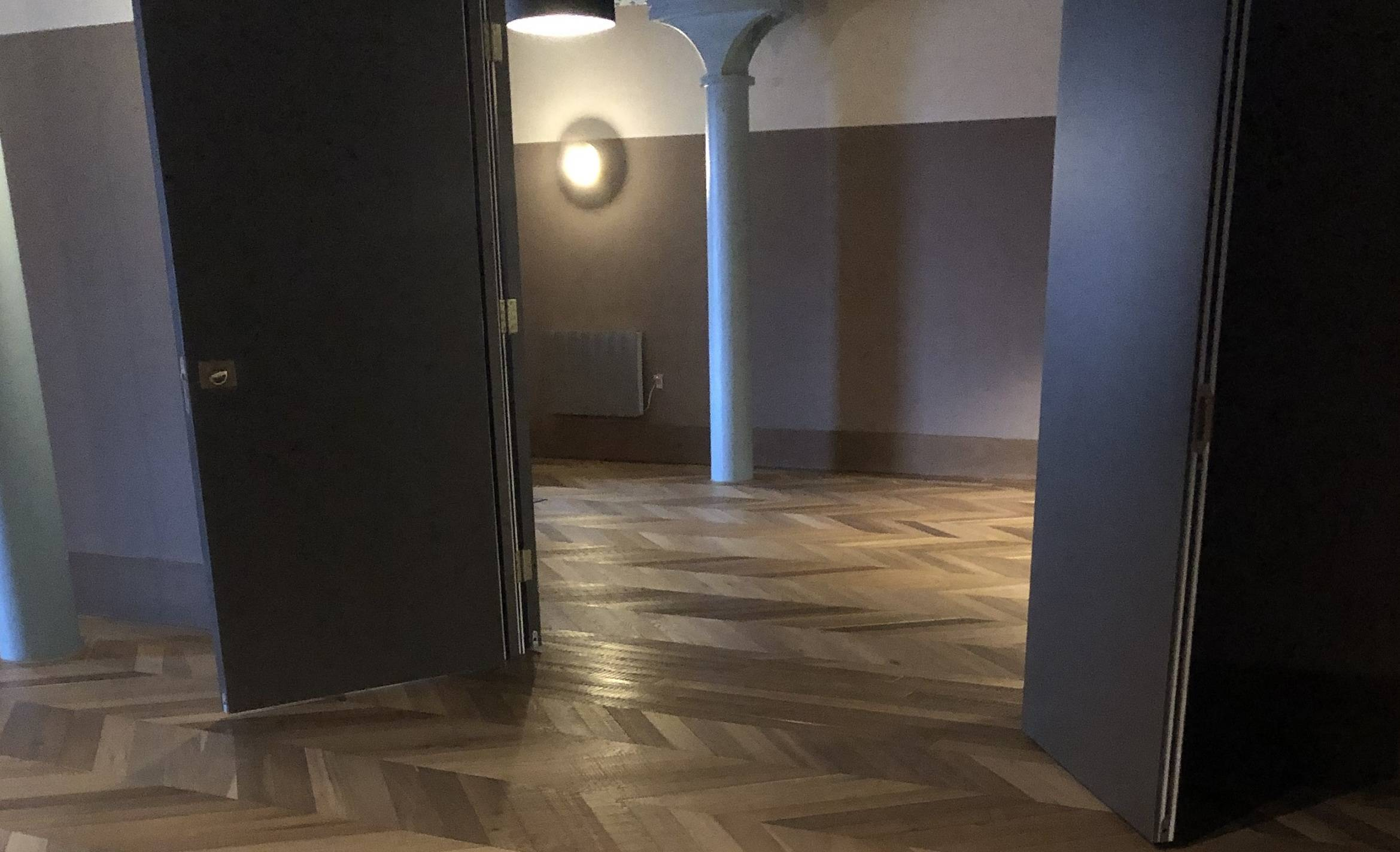 Deep Fumed band sawn chevron oak parquet flooring in the Apart Hotel Manchester