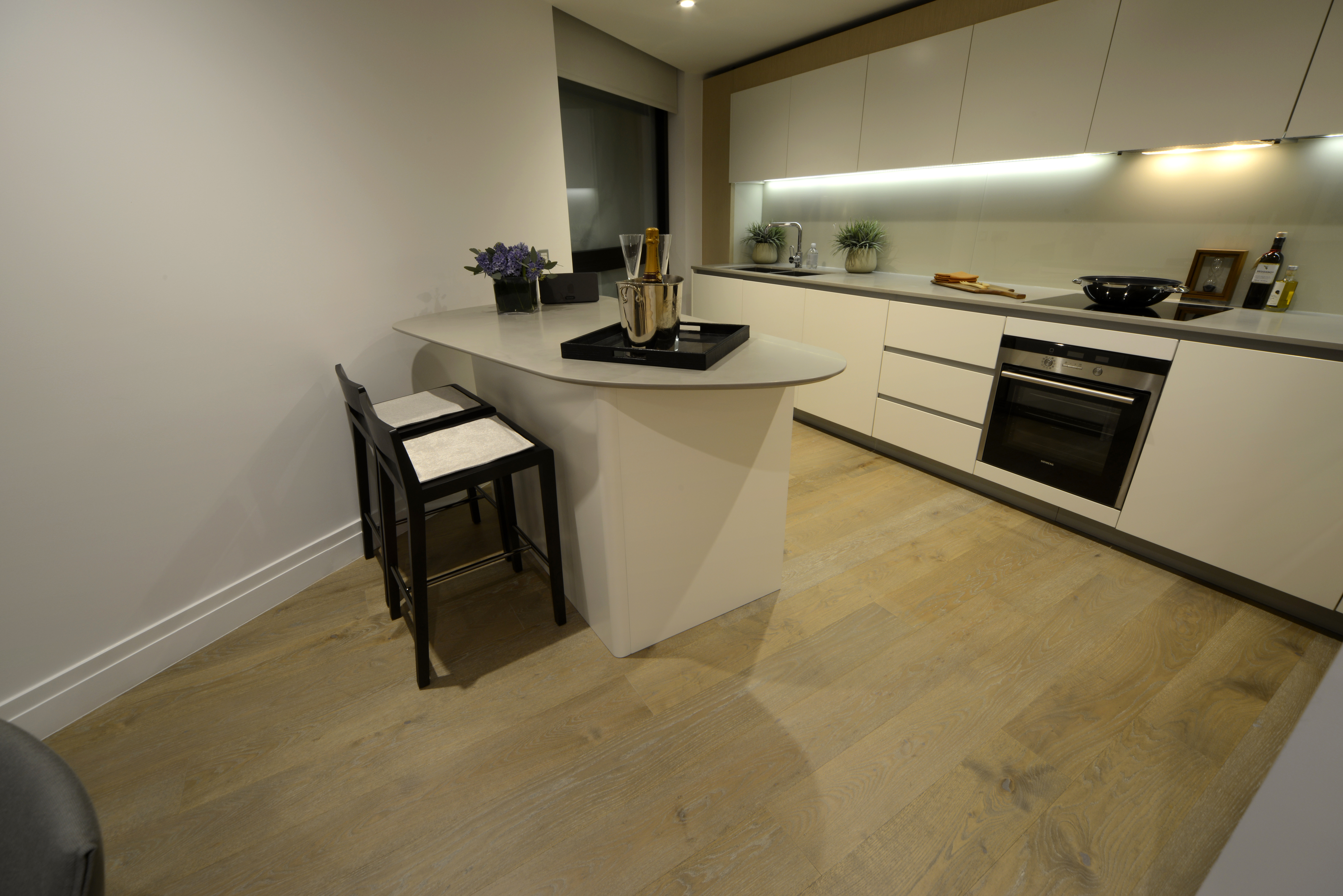 Fumed and Limed Lacquered Oak Floor fitted in kitchens throughout high rise development in London