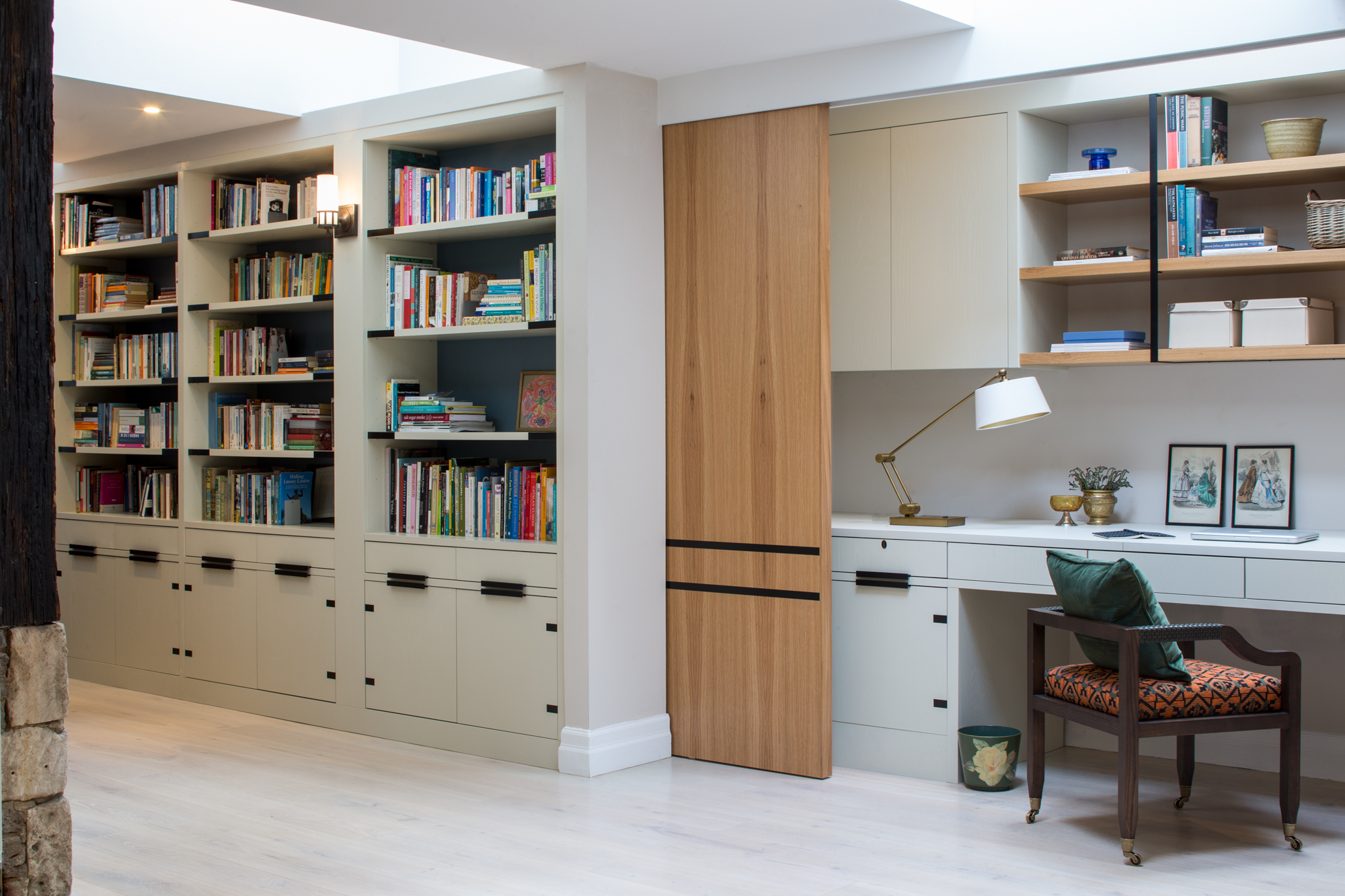 The desk space extends across the full length of the hallway and can be conveniently hidden from view by the large timber sliding doors.