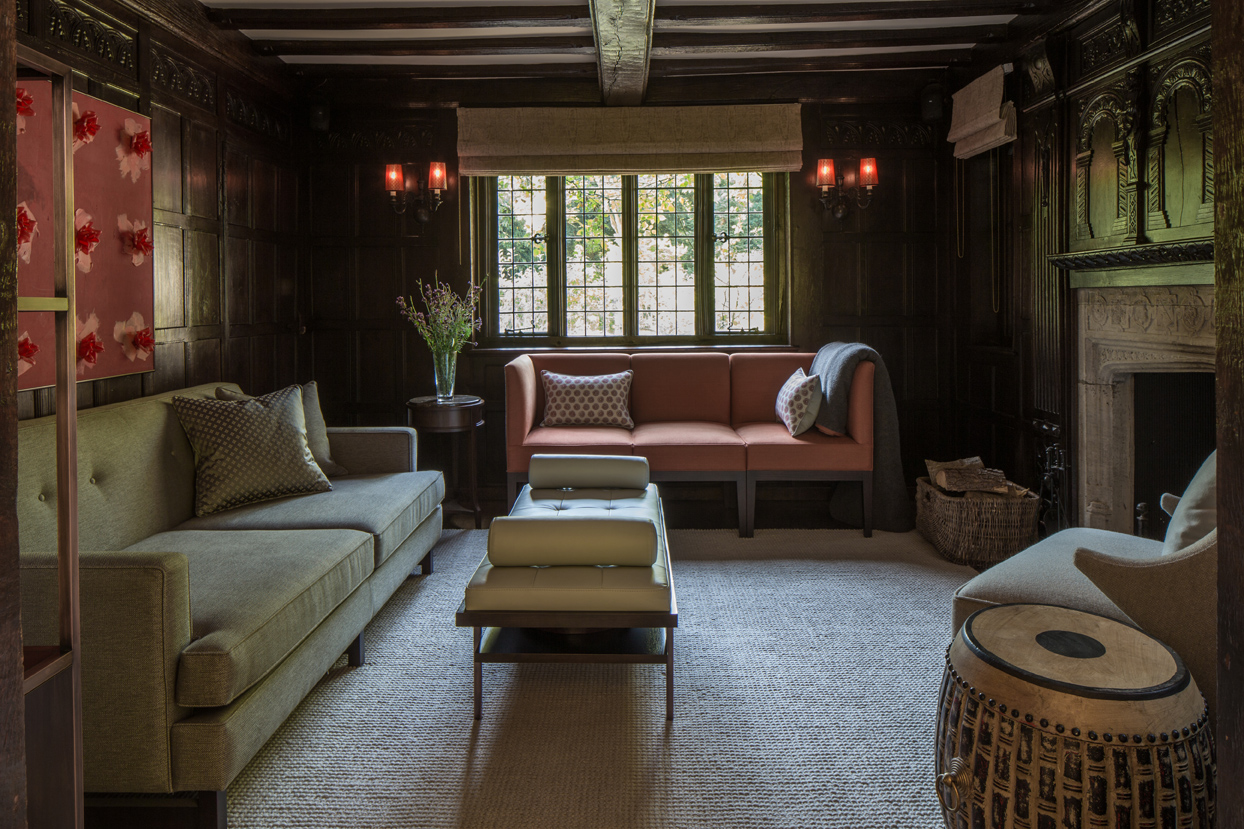 The snug has been designed as a haven to relax against the backdrop of the fireplace and features structured yet comfortable sofas.