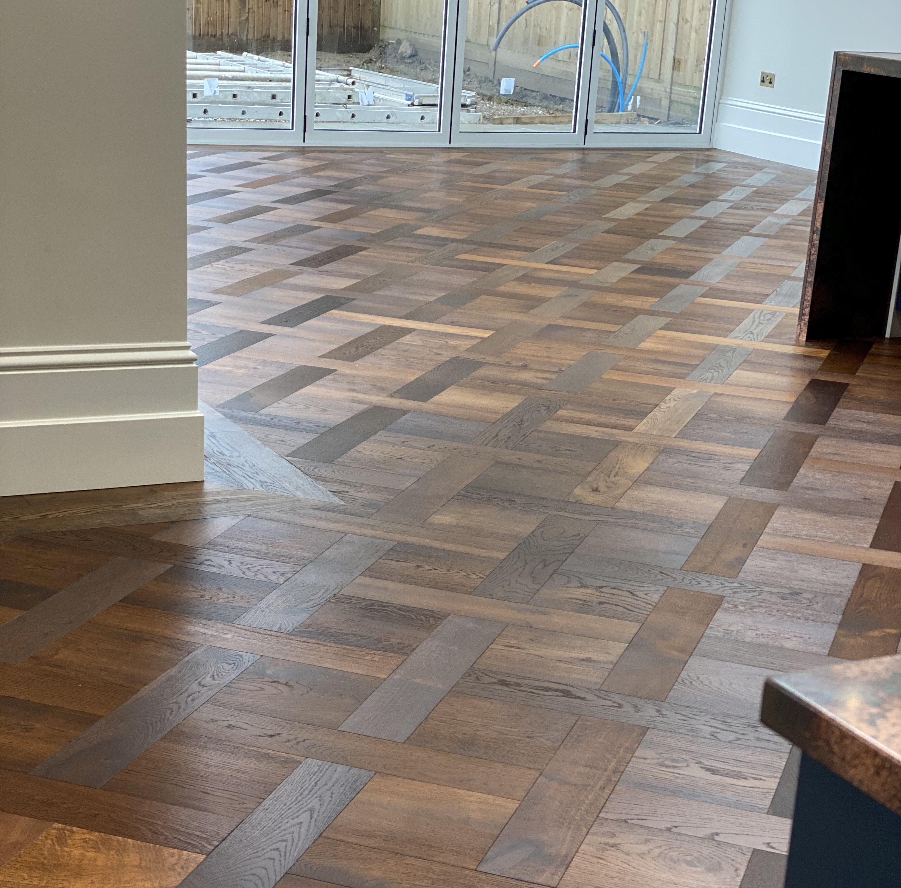 Herringbone Basket weave pattern parquet wood flooring in a hallway TW E931