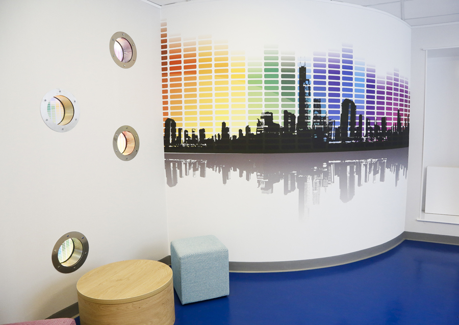 The chillout room was designed specifically for teenagers, to maintain some connection with the rest of the centre we incorporated 4 porthole windows within one of the walls and specified printed acrylic inserts which mirrored the adjacent wall graphic.