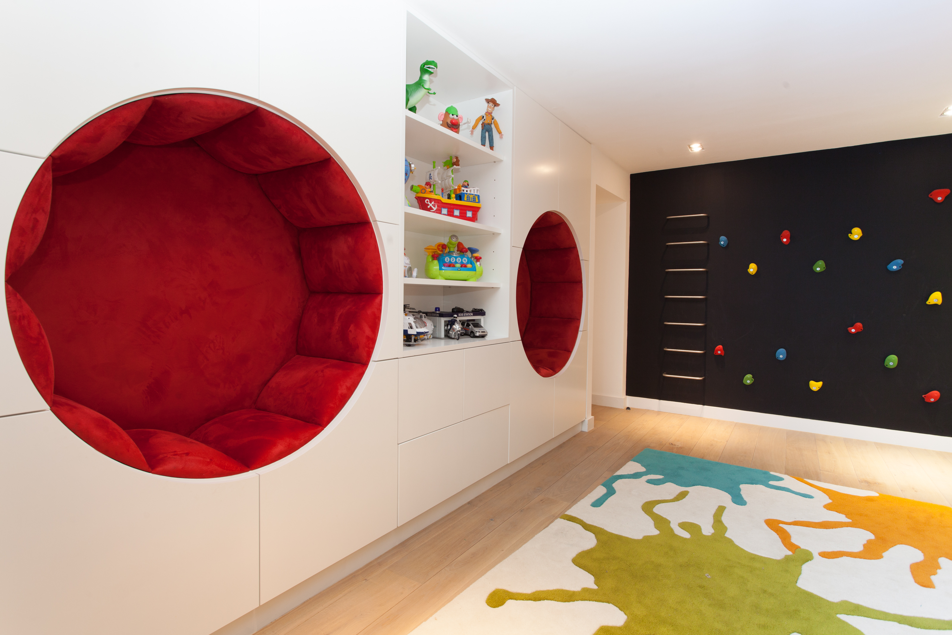 children's playroom with circular seating and chalkboard climbing wall