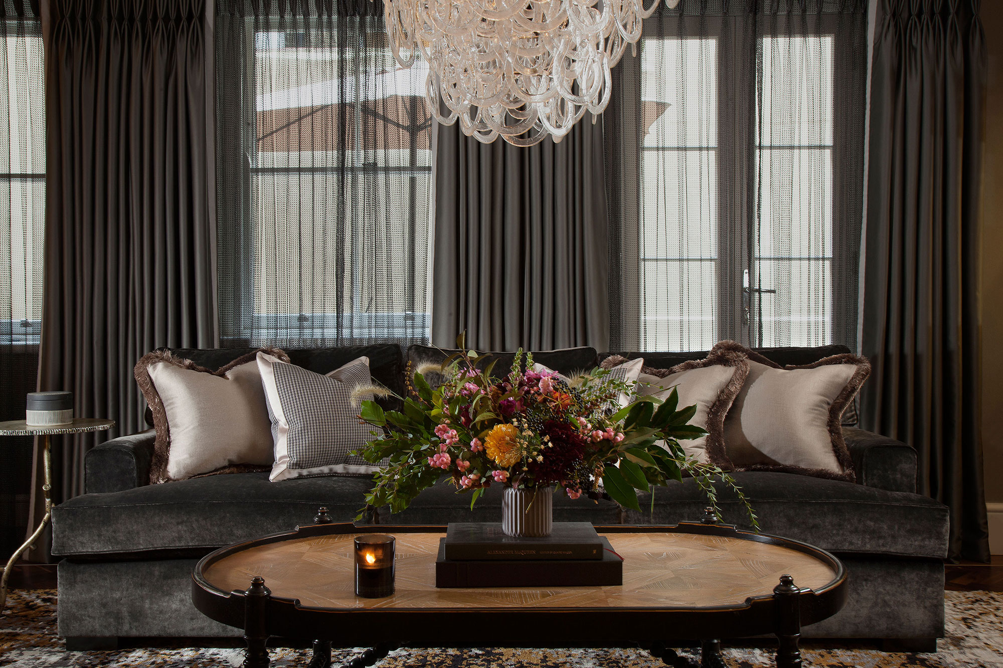 cosy living room with layers of texture and a striking chandelier