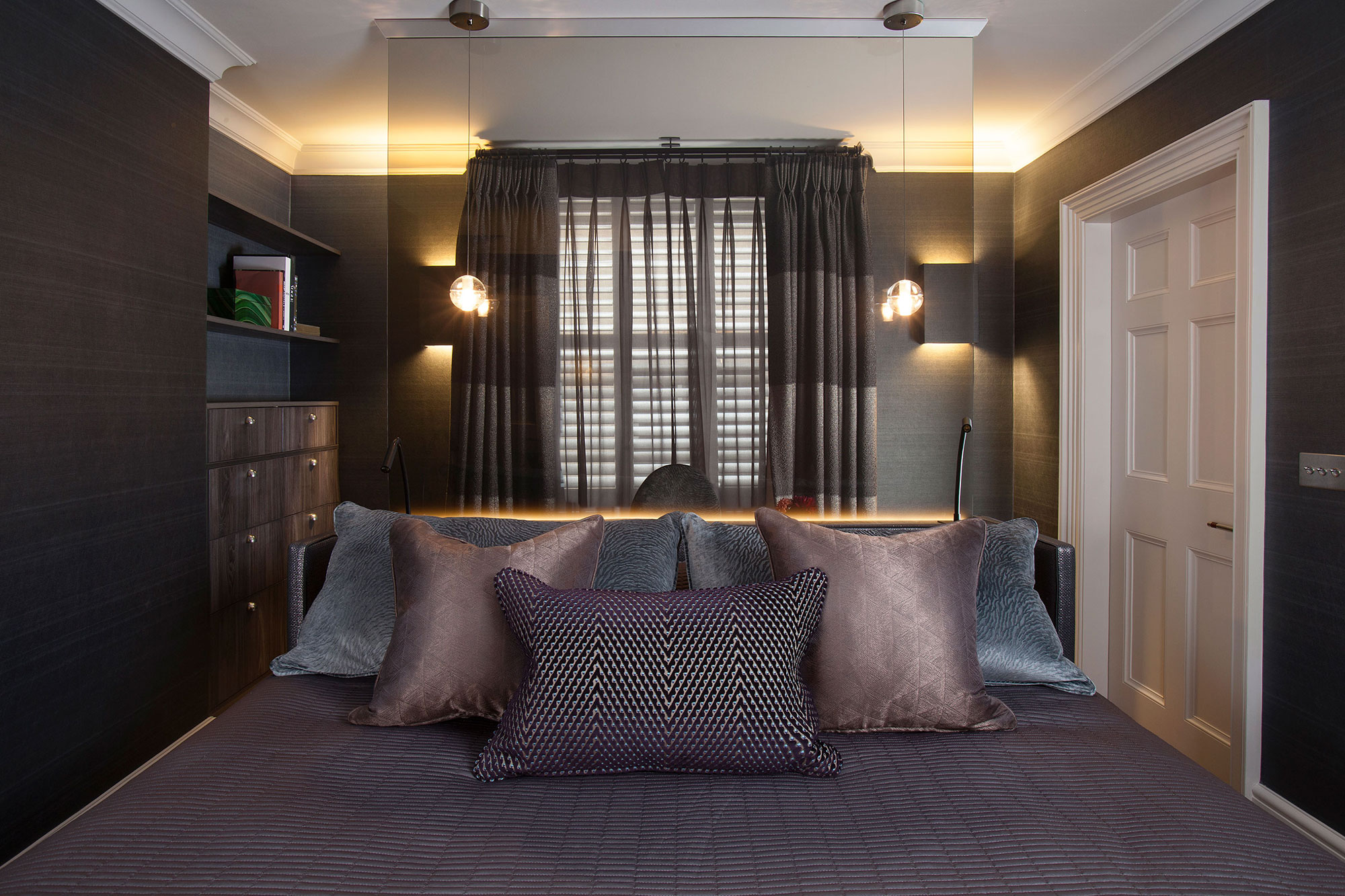 master bedroom with desk or work space separate by a sheer screen