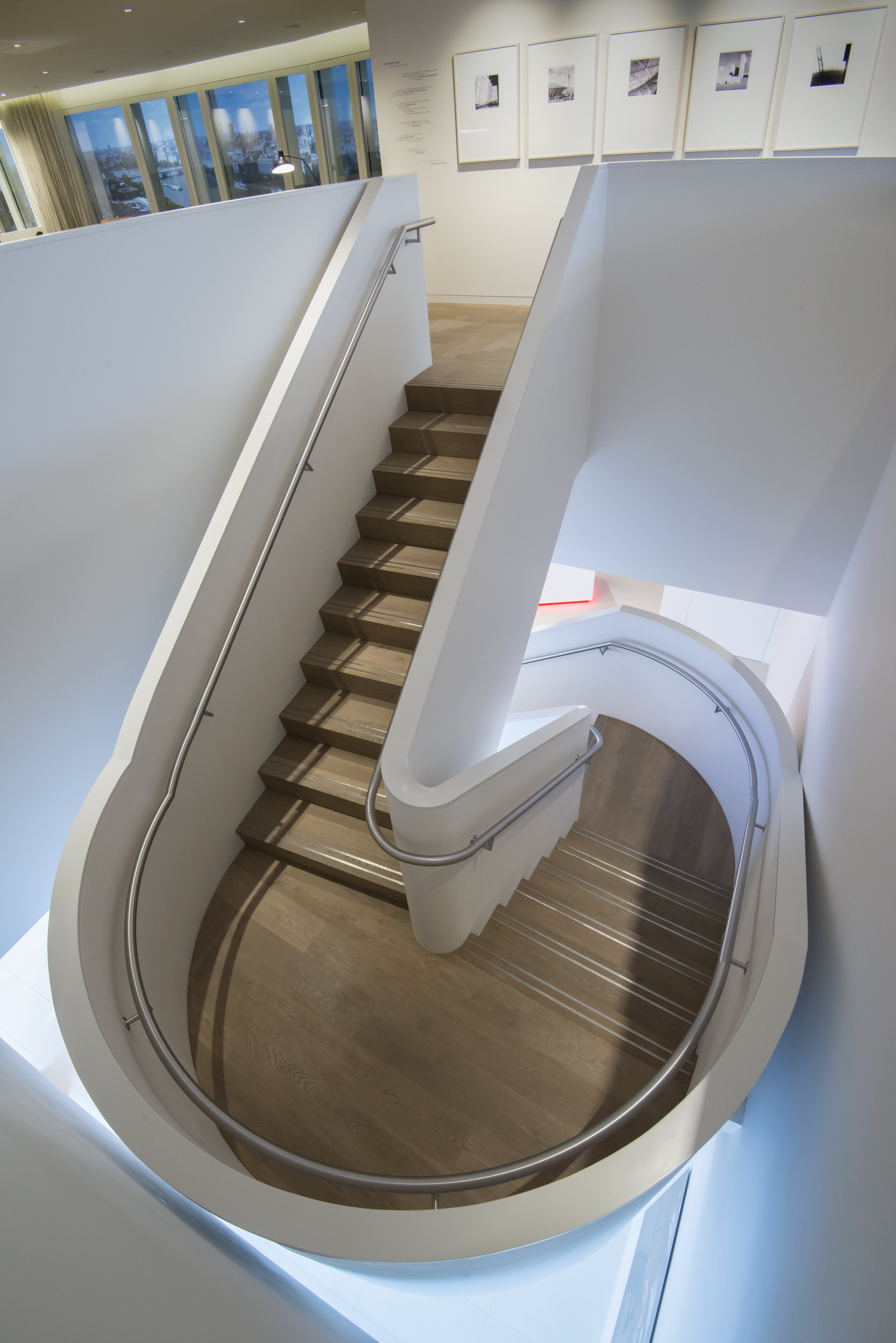 Fumed Oak Flooring clad to spiral stair case with polished metal grips
