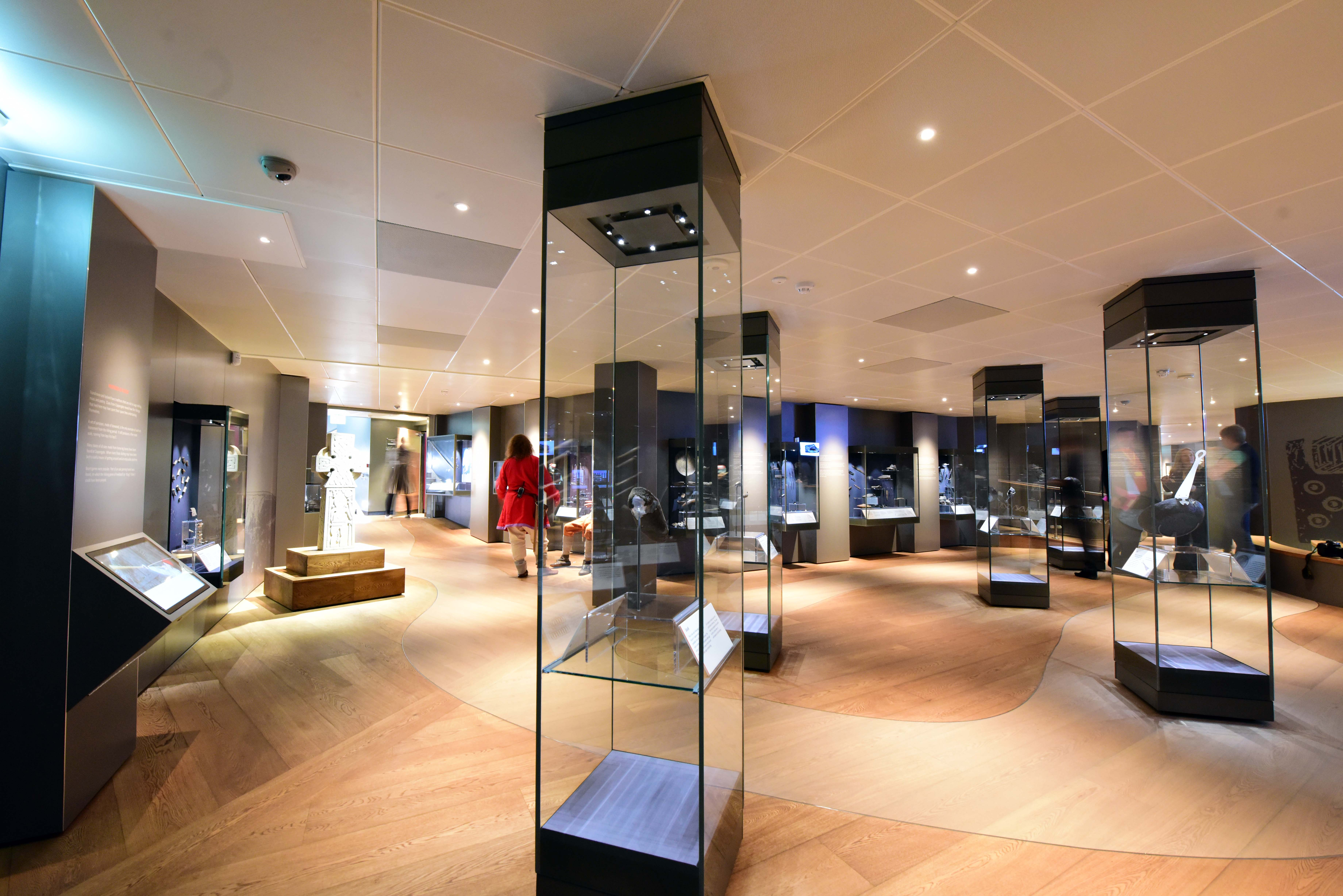 Select grade Oak flooring routed and oiled with various pigments to create meandering river in Viking Museum, York