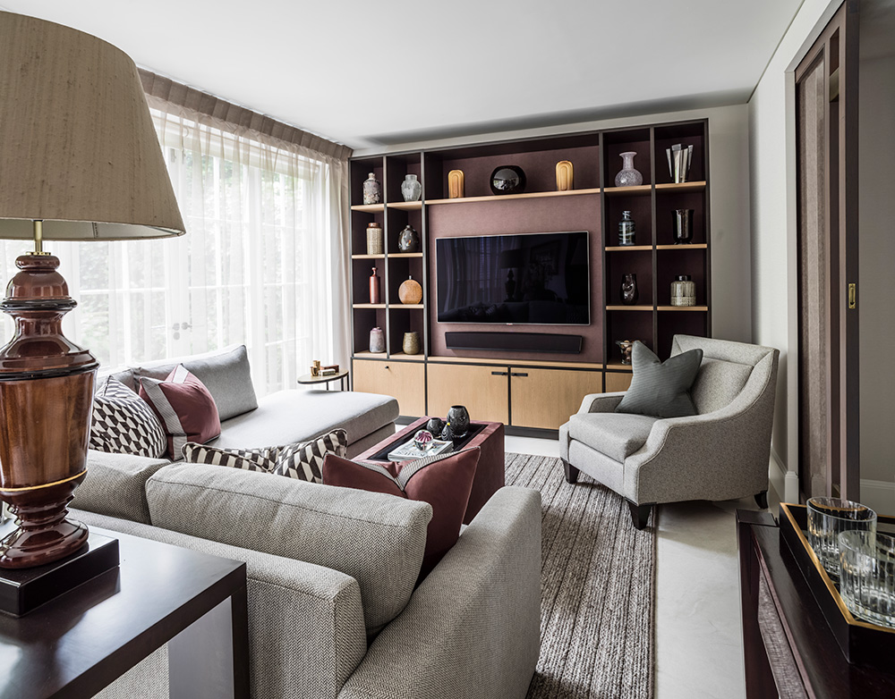 versatile living room with large sofa, tv and built-in storage and display joinery