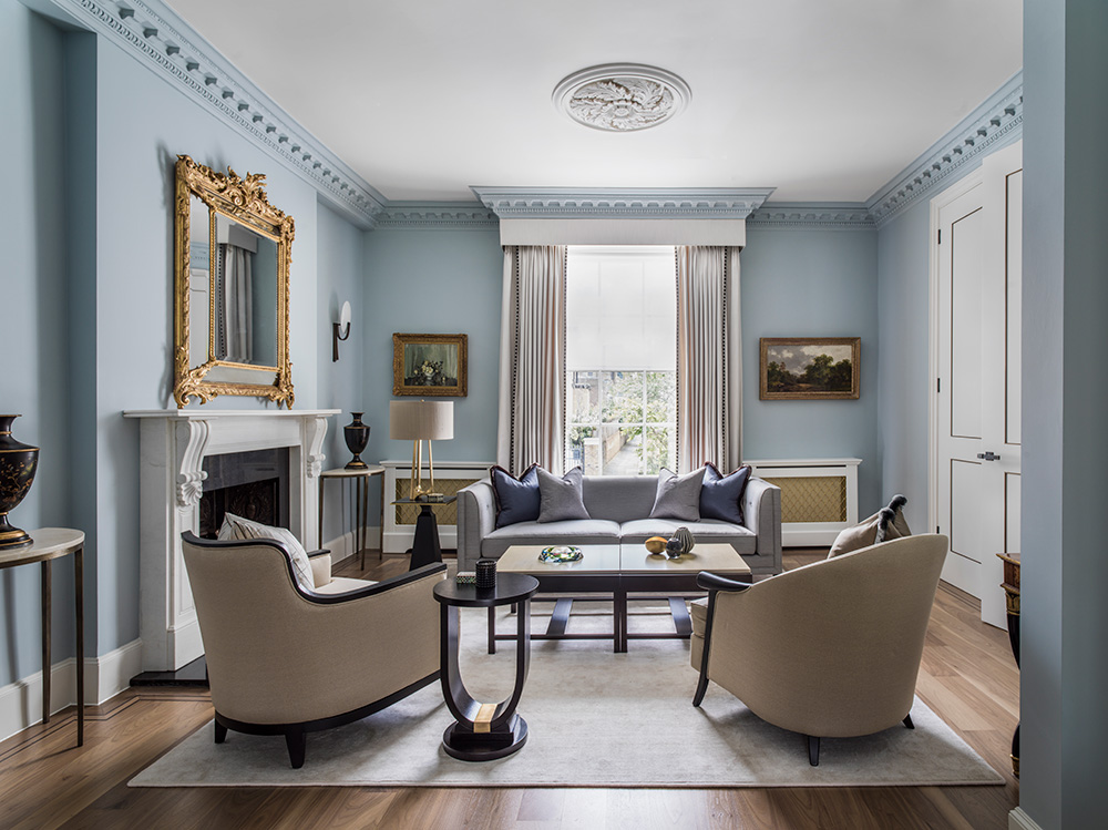 elegant reception room with classic-contemporary furniture and pale blue walls