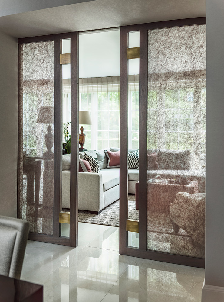 timber pocket doors with glazed glass and metal detail