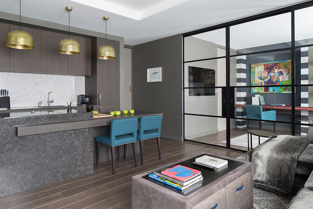 open plan living room and kitchen separated by metal internal doors