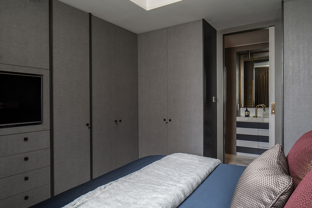 master bedroom with wall-to-wall cupboard storage