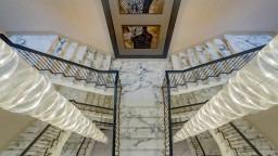 Calacatta marble double flight staircase in Millgate development